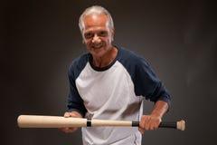 Portrait of a senior man posing with a baseball bat Royalty Free Stock Photo