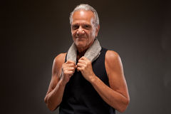 Portrait of a senior man posing with a towel Royalty Free Stock Photos