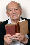Portrait of a senior man reading a book Royalty Free Stock Images