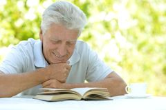 Man reading interesting book Stock Images