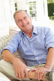 Portrait Of Senior Man Relaxing In Chair Stock Photo