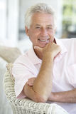 Portrait Of Senior Man Relaxing In Chair Royalty Free Stock Image