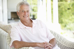 Portrait Of Senior Man Relaxing In Chair Royalty Free Stock Images