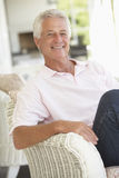 Portrait Of Senior Man Relaxing In Chair Royalty Free Stock Photos