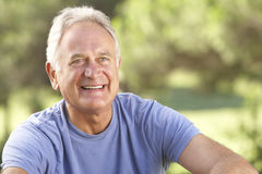 Portrait Of Senior Man Relaxing In Countryside Royalty Free Stock Photo
