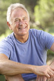 Portrait Of Senior Man Relaxing In Countryside Stock Photos