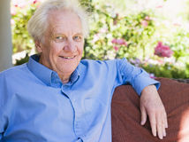 Portrait of senior man relaxing at home Stock Images