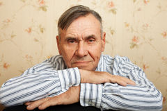 Portrait of senior man relaxing at home Royalty Free Stock Photography
