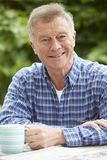 Portrait Of Senior Man Relaxing At Home Royalty Free Stock Photo