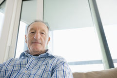 Portrait of senior man relaxing in living room Royalty Free Stock Image