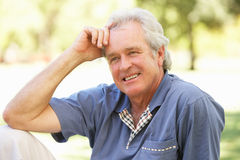 Portrait Of Senior Man Relaxing Outdoors Royalty Free Stock Photo