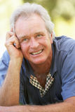 Portrait Of Senior Man Relaxing Outdoors Royalty Free Stock Image