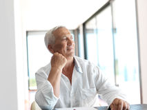 Portrait of senior man relaxing in sofa Royalty Free Stock Images