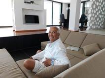 Portrait of senior man relaxing in sofa Stock Images