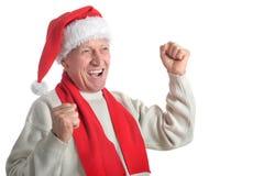 Senior man in Santa hat Stock Images