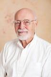 Portrait - Senior Man Serious. Portrait of a serious senior man wearing glasses Royalty Free Stock Photography