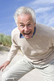 Portrait of senior man shouting on beach Royalty Free Stock Image
