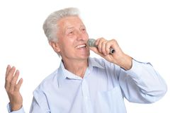 Portrait of senior man singing karaoke. Isolated on white background Royalty Free Stock Image
