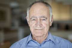 Portrait Of A Senior Man Smiling At The Camera stock photography