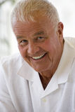 Portrait of senior man smiling, close-up Stock Photography