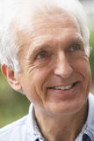 Portrait Of Senior Man Smiling Happily Royalty Free Stock Photography