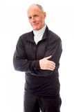 Portrait of a senior man standing with his arms crossed Royalty Free Stock Photography