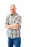 Portrait of a senior man standing with his arms crossed Stock Photos