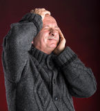 Portrait of senior man suffering from headache Stock Images