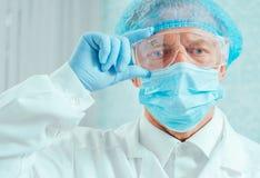Portrait of senior man surgeon Stock Photo