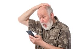 Senior man surprized with something at mobile smartphone, isolated on white. Portrait of senior man surprized with something at mobile smartphone, isolated on Stock Photo