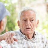 Two senior men talking in park Stock Photography