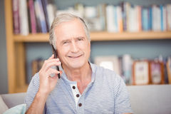 Portrait of senior man using mobile phone Stock Photography