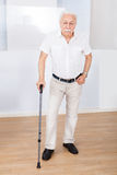 Portrait Of Senior Man With Walking Stick Royalty Free Stock Photos