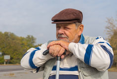 Portrait of senior man with walking stick Stock Images