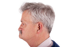 Portrait of a senior man wearing hearing aid Stock Images