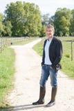 Portrait senior man in wellington boots Stock Photography
