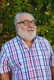 Portrait of senior man in the garden Royalty Free Stock Photos