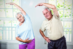 Portrait of senior man and woman exercising. At health club Royalty Free Stock Image