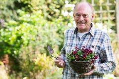 Portrait Of Senior Man Working In Garden Stock Photo