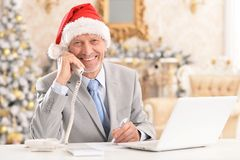 Portrait of a senior man working with laptop royalty free stock photography