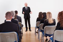 Portrait Of A Senior Manager Giving Presentation royalty free stock photo