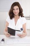 Portrait of a senior manager reading balance sheet. Stock Image