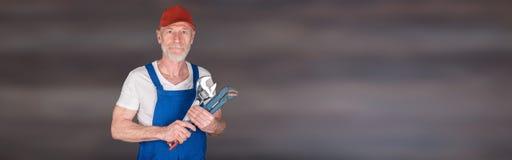 Portrait of senior mechanic Stock Photos