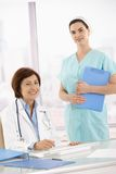 Portrait of senior medical doctor with assistant Stock Photo
