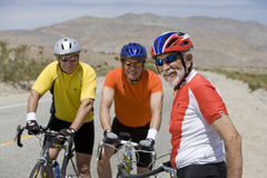 Portrait Of Senior Men Riding Bicycles Stock Photo