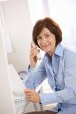 Portrait of senior office worker sitting at desk Stock Images
