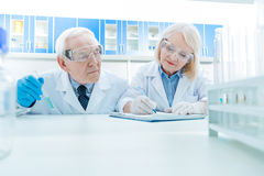 Portrait of senior scientists working on experiment Royalty Free Stock Images