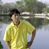 Senior asian man. A portrait of a senior south asian man by lake Royalty Free Stock Photo