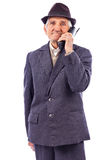 Portrait of a senior talking on phone royalty free stock photos