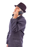 Portrait of a  senior talking on phone and looking away Royalty Free Stock Images